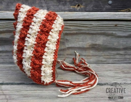 Free crochet bonnet pattern.  The Little Flames Pixie Bonnet is available in 6 sizes.  Designed by Creative Threads by Leah, available exclusively on Cre8tion Crochet