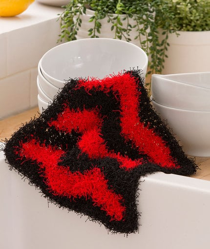 This free crochet dish scrubbie pattern comes in a fun chevron design and used the NEW Scrubby yarn by Red Heart Yarns. I had a lot of fun designing this easy pattern and I hope you do too.