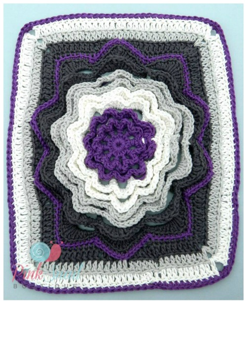 Spinning Deca-Petal Flower Tile free crochet pattern. I'd love to see this made into an afghan.