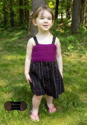 Upcycled children's button down dress made from a mens shirt.  Free pattern and tutorial.