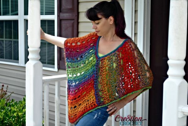Easy lace poncho, designed with Unique Yarn by Lion Brand.  Two sizes.  Free.